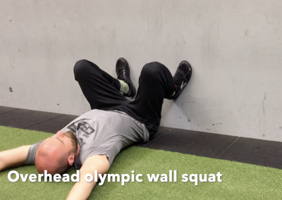 Overhead olympic wall squat